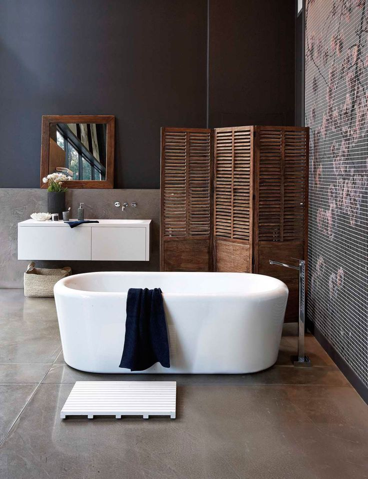 """Warm, dark and handsome, this bathroom makes use of earthy tones and a subtle industrial feel for a space you'll enjoy for years to come  Handsome and welcoming Your Home and Garden stylist Emily Somerville-Ryan selected the products for this bathroom look from Mitre 10 Mega. """"I've gone for a warm, earthy feel. Stone, …"""