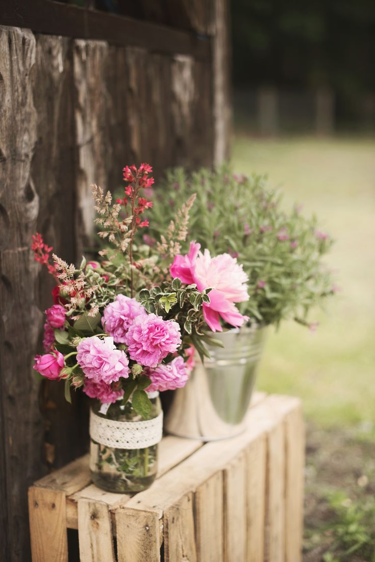 Flowers in decorative jars by GRUNT STUDIO