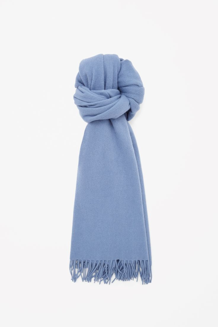 An oversized style, this versatile scarf is made from a soft blend of wool and cashmere with classic tassel edges.