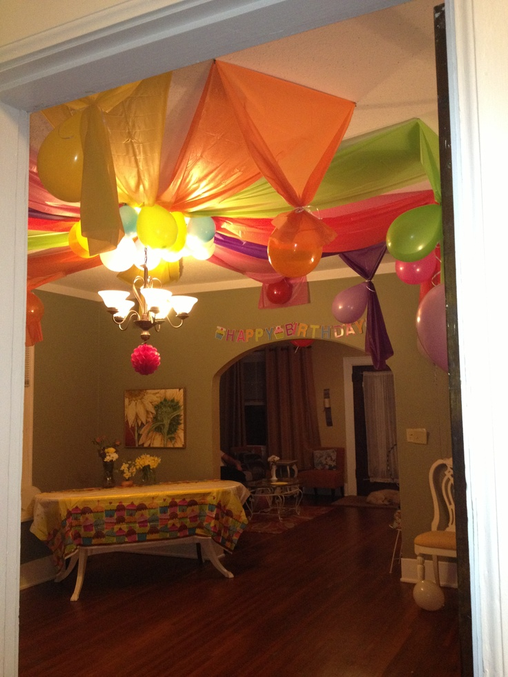 Circus top birthday decorations made from plastic table cloths and balloons for Evalee's 3rd birthday