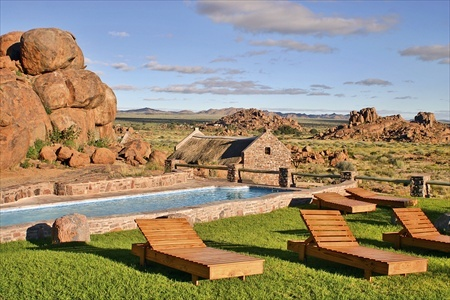 The swimming pool of the Canyon Village with a panoramic view of the landscape.