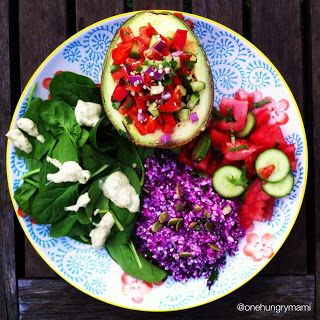 Salsa stuffed avocado with cauliflower and red cabbage rice