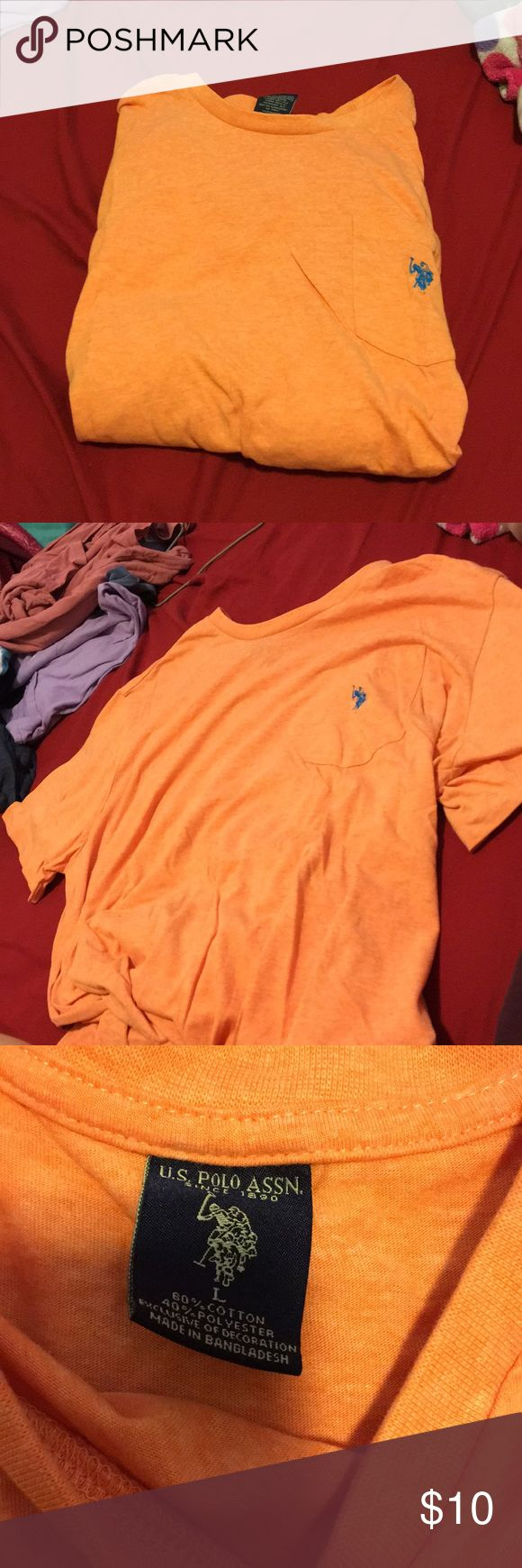 Men's polo shirt Bought it, ended up not liking the color on me. NWOT orange polo shirt with blue logo on the pocket. Men's large, short sleeve. U.S. Polo Assn. Shirts Tees - Short Sleeve