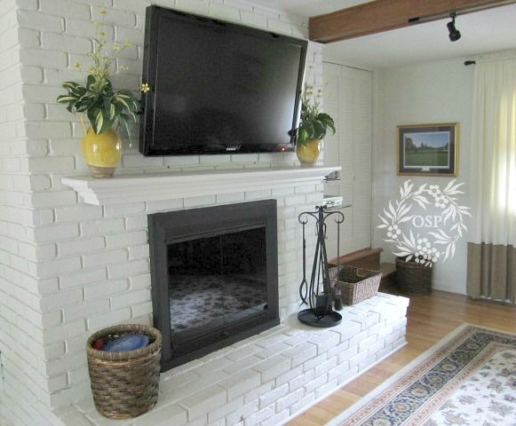 Extend fireplace. add step and mantel. Painted Brick Fireplace Makeover