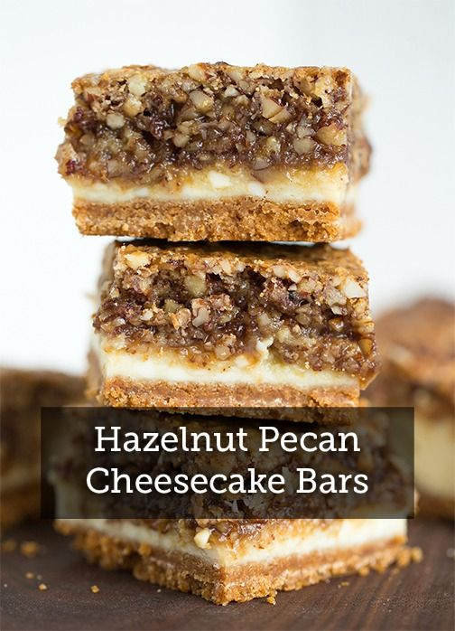 Hazelnut Pecan Cheesecake Bars are an unforgettable recipe. They've got a crust of graham cracker crumbs, a filling of delicious cheesecake, and a topping of syrupy hazelnuts and pecans, baked to perfection.