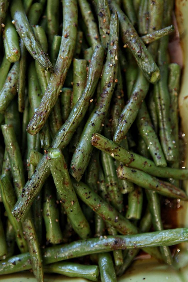 Roasted Green Beans are simple and utterly delicious! Toss fresh green beans in a mixture of balsamic vinegar, mustard, extra virgin olive oil, Sriracha sauce, black pepper and sea salt then roast to create a slightly sweet and spicy side dish for the holiday table.