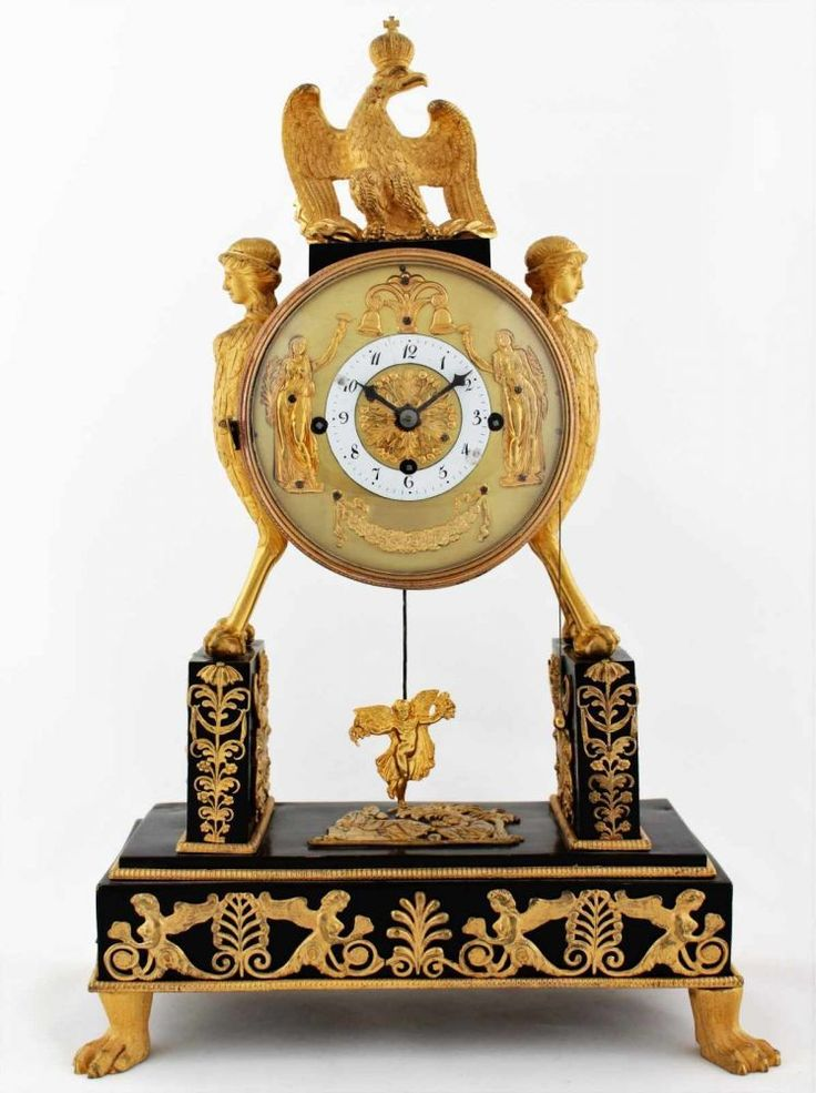 Rare Austrian Empire clock with automaton Austria, Vienna, cca 1810, fire gilt bronze case with figural decoration and zoomorphic stylizations, partly patinated, movement in working condition, duration: 1 day, Graham escapement, Viennese grande sonnerie on bells, dial with automatons - two relief figures, enameled dial ring, blued steel hands, total size 38 x 25 x 13 cm.
