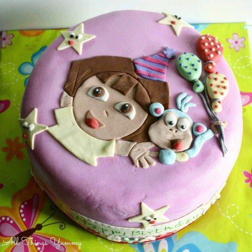 Cartoon Cakes - Dora The Explorer Cake | Pink Dora the Explorer Cake with Yellow and Pink Fondant Art | All Things Yummy #allthingsyummy #fondant #dora #cartoon #cakes