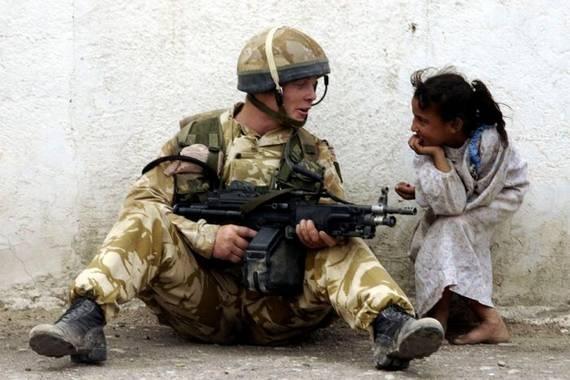 Iraq War, a soldier talking to a little girl