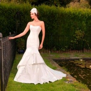 'Loretta'  Silk fishtail gown with button-up back and train Size 12 – Was £1250, Now £600 Fancy trying on this gown?  Email us now to make an appointment:   sarah@bridalgallerycoventry.co.uk
