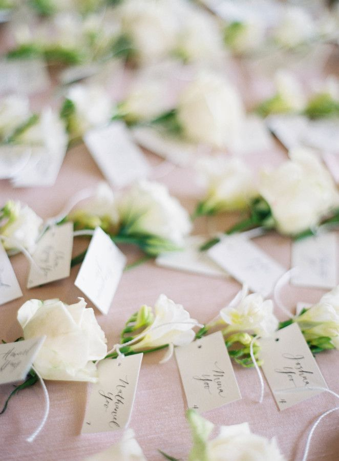 Floral wedding escort cards: http://www.stylemepretty.com/2017/02/24/a-classic-oscar-de-la-renta-dress-set-the-tone-for-this-half-moon-bay-soiree/ Photography: Jen Huang - http://jenhuangphoto.com/