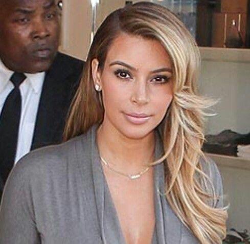 Kim Kardashian's layered blonde wavy new haistyle post ...