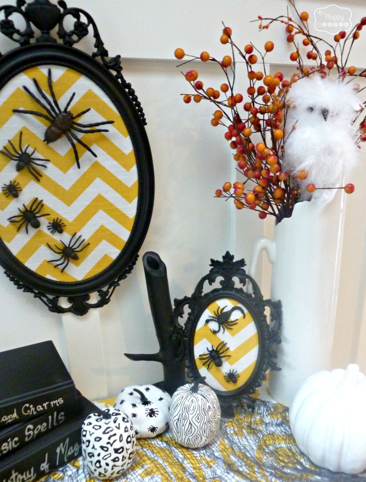 DIY Halloween spider art using yellow chevron fabric in vintage upcycled frames at thehappyhousie #Halloween Decorating #Halloween Art