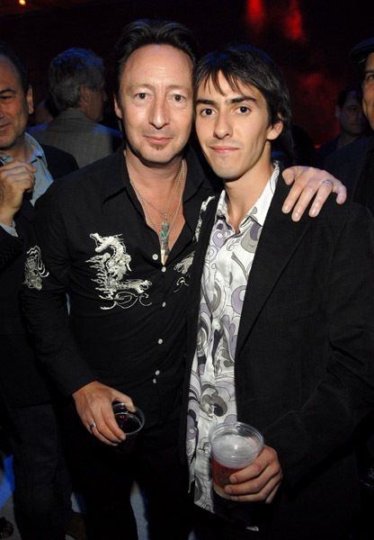 Rare Beatles -- Julian Lennon and Dhani Harrison -- they look SO much like their Dads!  Squee.
