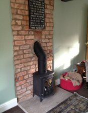 AGA Little Wenlock on indian stone hearth with twin wall insulated flue system.