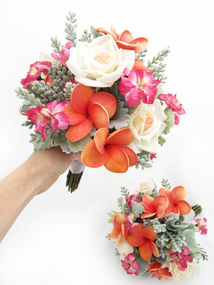 Medium posies of coral frangipanis, hot pink stock florets, pale peach classic roses and dusty miller. Find your perfect wedding flowers at www.loveflowers.com.au