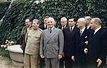 Joseph Stalin and Harry Truman meeting at the Potsdam Conference on 18 July 1945. From left to right, first row: Premier Joseph Stalin; President Harry S. Truman, Soviet Ambassador to the United States Andrei Gromyko, Secretary of State James F. Byrnes, and Soviet Foreign Minister Vyacheslav Molotov. Second row: Brigadier General Harry H. Vaughan, Truman's confidant and military aide; Russian interpreter Charles Bohlen, Truman naval aide James K. Vardaman, Jr., and (partially obscured)…