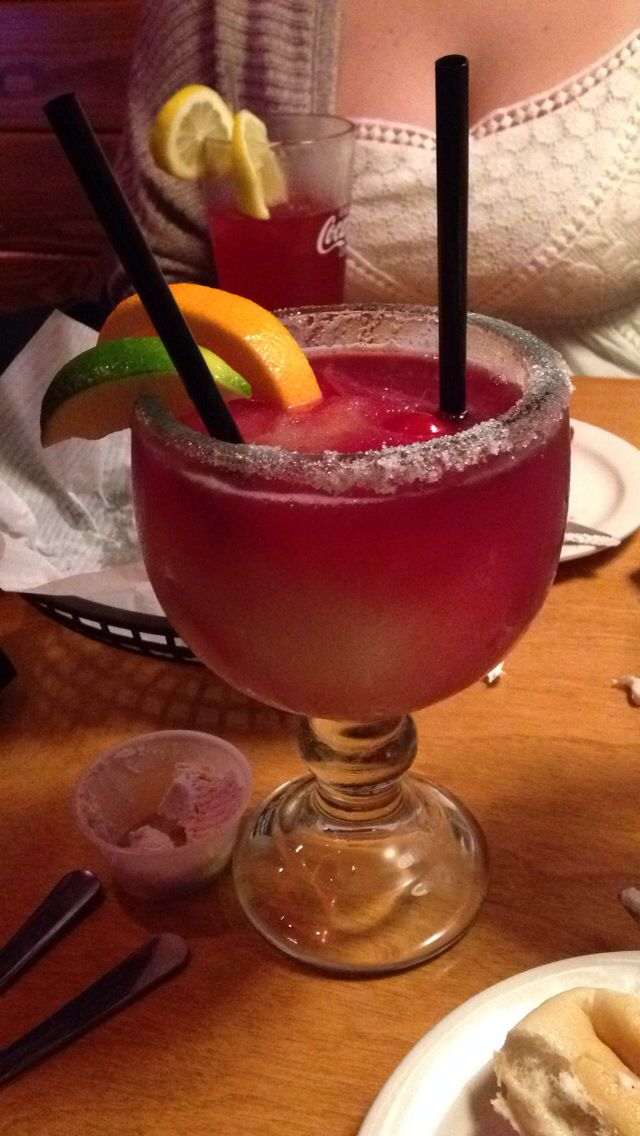 Recipe for Texas Roadhouse Sangria Margarita!!!    8 oz tequila 12 oz margarita mix 2 oz Rose's® lime juice  3 oz triple sec  3 - 5 oz sangria    Pour the tequila, margarita mix, lime juice and triple sec into an average sized blender filled with crushed ice, and blend well. Dip rim of a 16-oz. margarita glass in the blender to wet, and apply salt if desired. Pour the blender mixture into the glass until 2/3 full, add the sangria, and serve.