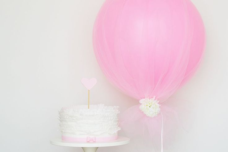 Turn a simple cake into a stunning masterpiece by adding a tulle balloon. Learn how to make a tulle balloon in this step-by-step DIY guide from Sweet Society.
