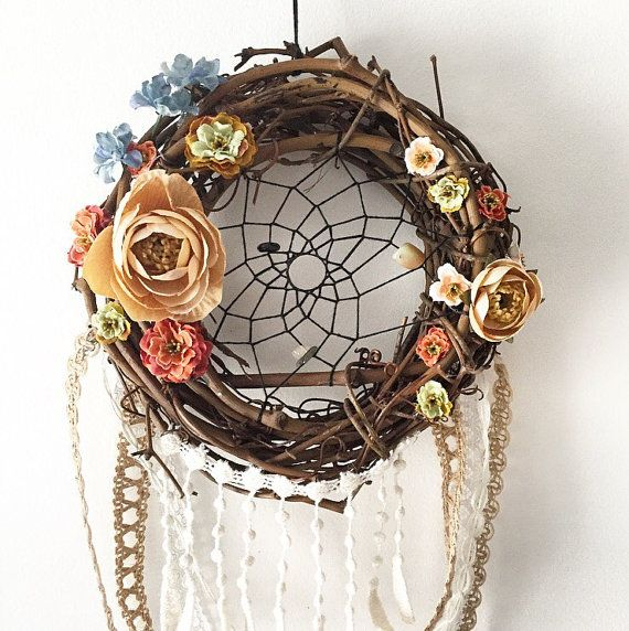 This is a sweet small dreamcatcher wreath, handwoven with black thread & gemstone beads, decorated with an assortment of pretty paper flowers &