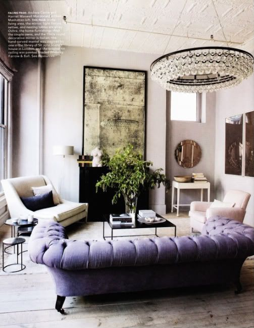 The green from the plant really makes everything in the room pop from the lavender sofa to the ochre crystal chandelier