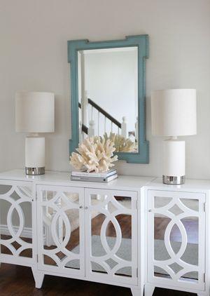 Jana Bek Design - entrances/foyers - fretwork mirror, teal mirror, teal fretwork mirror, foyer mirror, mirrored cabinet, white mirrored cabinet, beachy accents, coral accents, decorative coral,