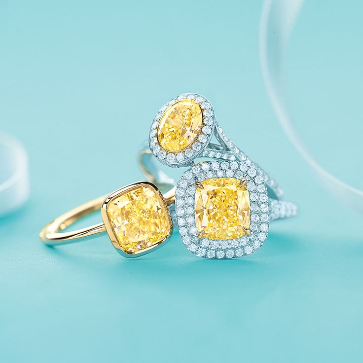 Tiffany & Co. yellow diamond rings, from left: Tiffany Bezet in 18k gold, Tiffany Soleste® oval in platinum and gold and Tiffany Soleste® in platinum and 18k gold. #TiffanyPinterest