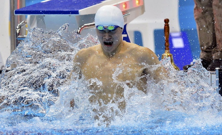 Chinese Sun Yang won the men's gold in the final of the 1500 m freestyle, 4 August. It sets the new world record of 14 minutes 31 seconds and 02 hundredths - Le Monde