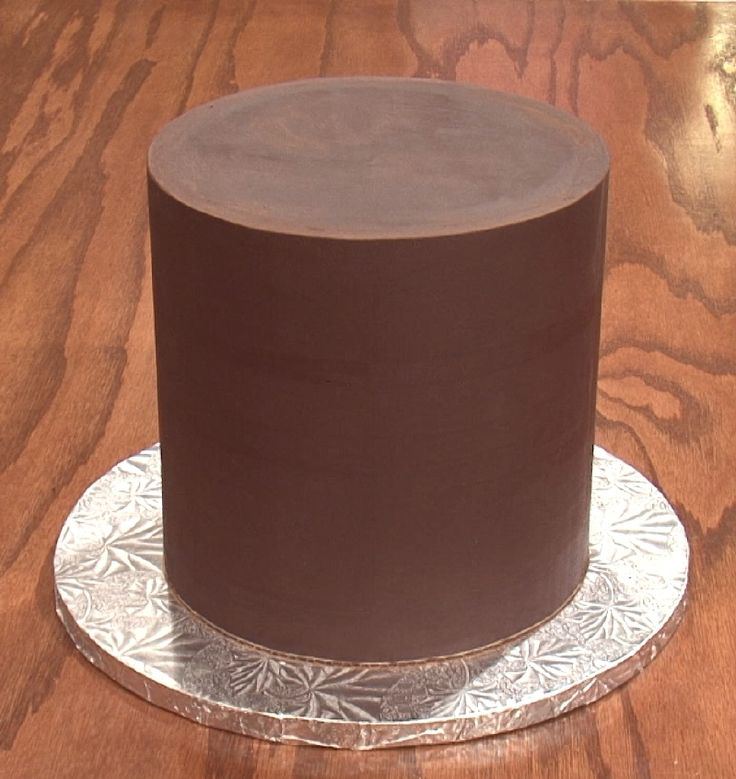 A naked ganached cake. We have a video tutorial here in the website on how to do this; it's not hard! :) - SugarEd Productions