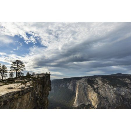 A Yosemite National Park visitor stands at Taft Point which overlooks Yosemite Valley and El Capitan California United States of America Canvas Art - Tracy Barbutes Design Pics (19 x 12)