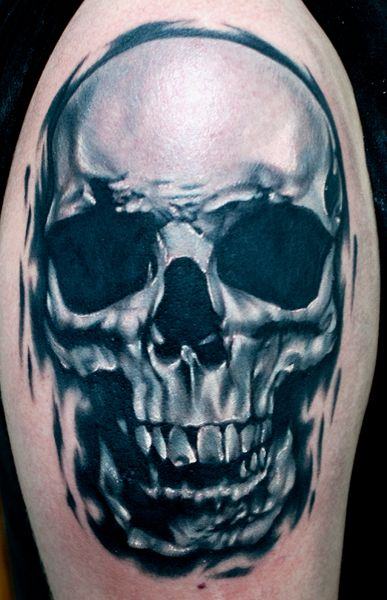 Realistic black and grey skull tattoo