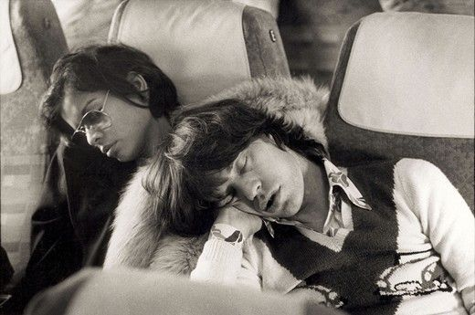 Singer Mick Jagger of the Rolling Stones sleeping alongside his wife Bianca Jagger the morning after the end of their European tour party in Berlin, Germany on October 20, 1973