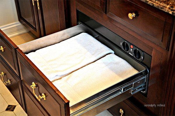 Luxury goes a long way when updating or selling. Six Ways to splurge on your home.  ~ Towel warming drawer in a home's bathroom to wrap yourself in warmth after a shower!