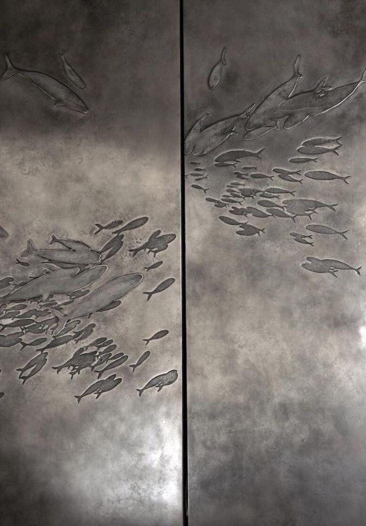 Elevator door. Bas relief