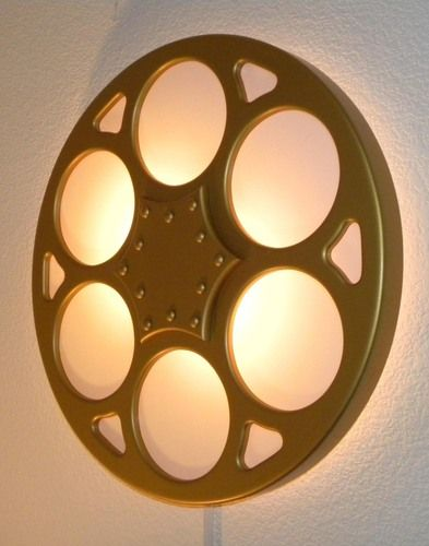 We love this Backlit Film Reel wall sconce! You can customize it to fit your decor by choosing from black, silver, gold, 3 different sizes, and adding a dimmer to it would allow you to showcase your beautiful decor while comfortably watching your movie.