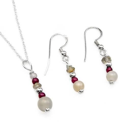 Jewelry Set With Precious Stones Pleasant jewelry set. Earrings with genuine garnets, labradorites and moonstones well made in 925 sterling silver. Necklace with garnets, labradorites and moonstones made in 925 sterling silver. Length 18inch. Gemstone info: 2 garnets, 0.50ctw