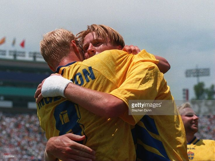 KENNET ANDERSSON OF SWEDEN IS CONGRATULATED BY HIS TEAM MATE #8 KLAS INGESSON AFTER HE SCORES THE FOURTH GOAL FOR SWEDEN AGAINST 1994 WORLD CUP FINALS THIRD AND FOURTH PLAYOFF MATCH AT THE ROSE BOWL STADIUM IN PASADENA, CALIFORNIA, July, 1994
