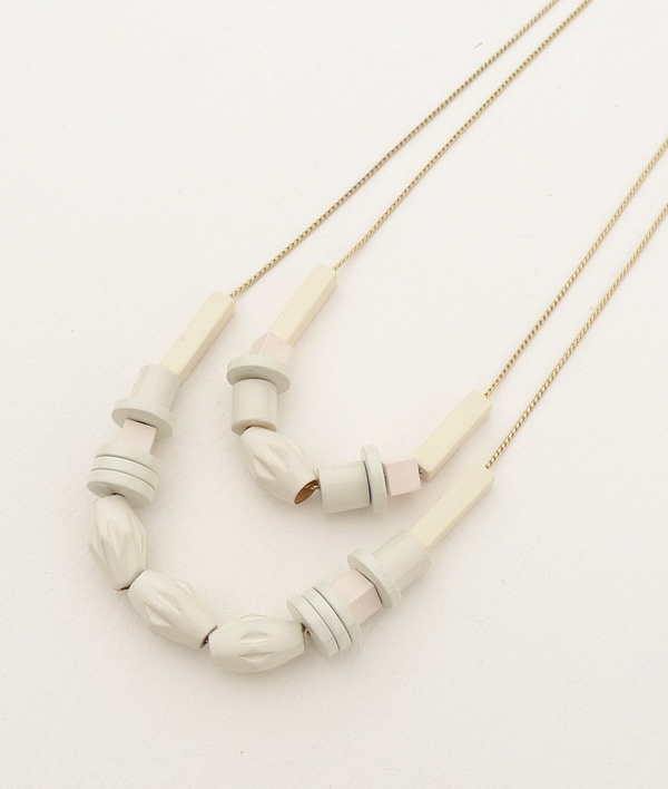 Creme necklace.