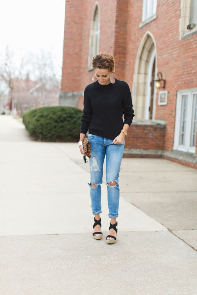 winter chic, black sweater, distressed denim, leather earrings, leopard clutch, wedges