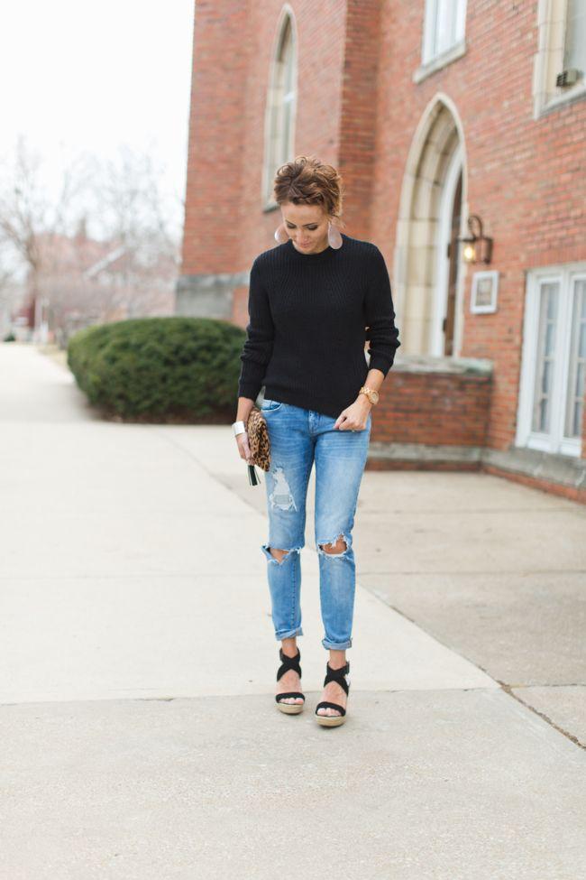 winter chic, black sweater, distressed denim, leather earrings, leopard clutch, wedges