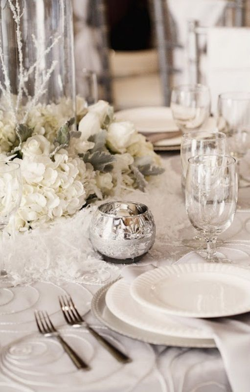 A Silver And White Tablescape Decorated With Hydrangea Roses Mercury Glass Wedding TablesWinter ReceptionsWinter