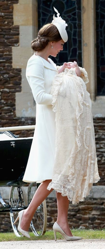 Catherine, The Duchess of Cambridge cradled Princess Charlotte while wearing an all-white look.