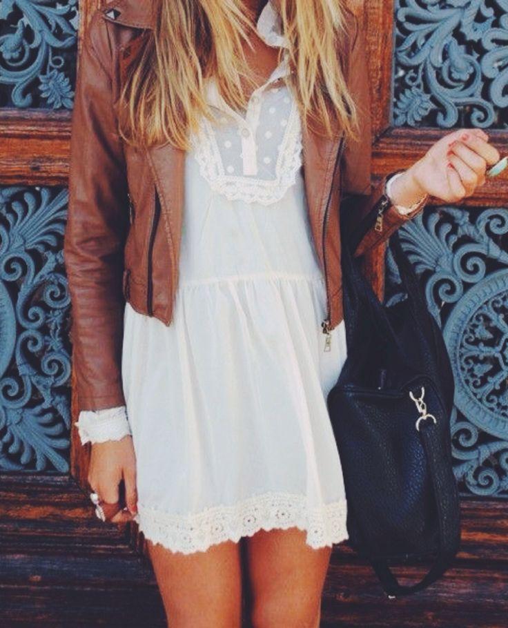 tan leather jacket. white dress.