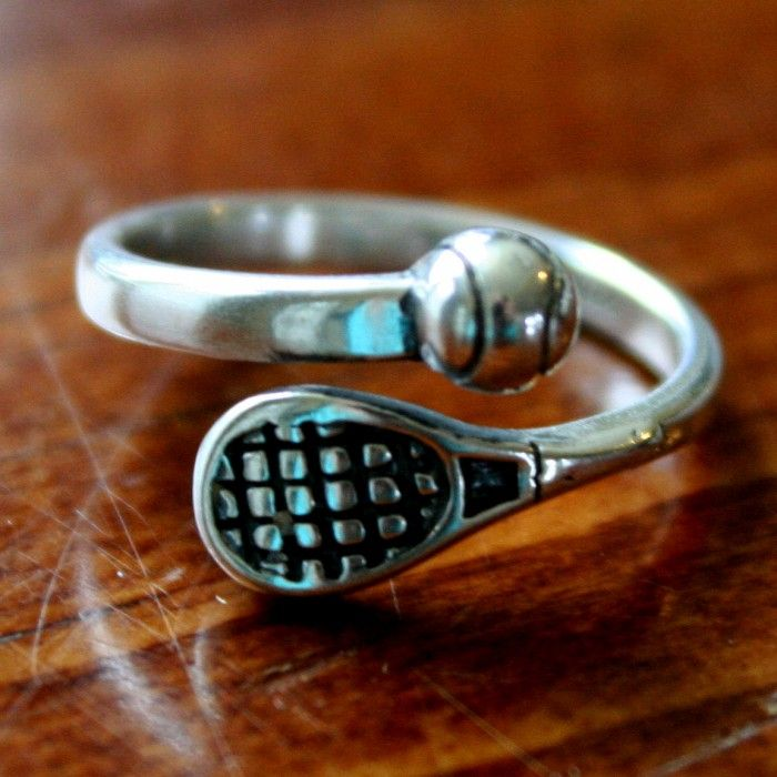 This sterling silvertennis racket and tennis ballring is a perfect gift for yourself, your favorite tennis player or tennis coach!The ring features an adjustable band accented with a tennis racket and tennis ball.