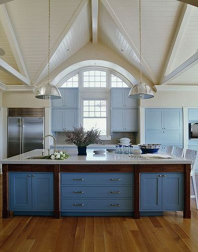 The nautical kitchen by Sherrill Canet Interiors - nice mix of blues and a beautiful ceiling -unusual...