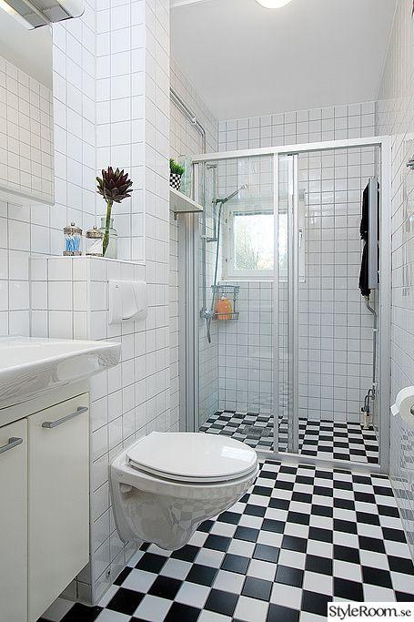 En till vägghängd toalett