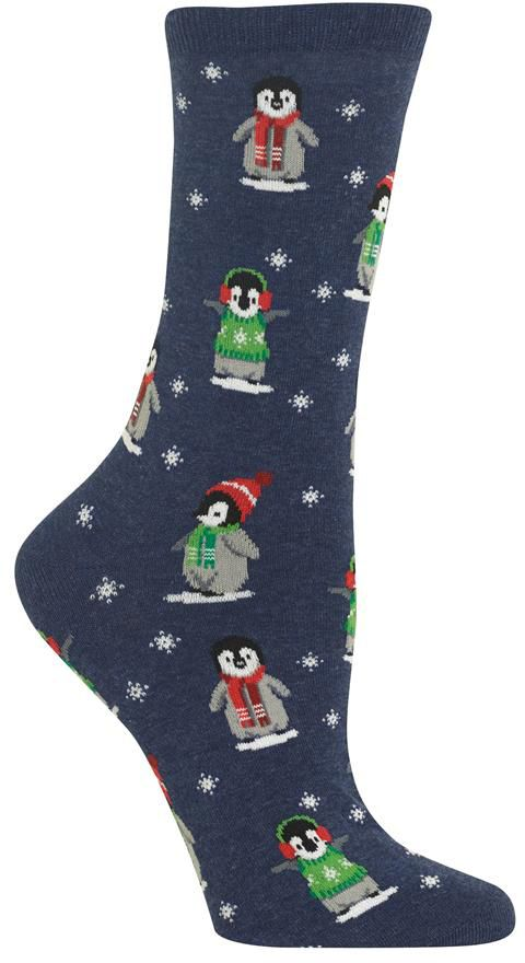Cute little penguin chicks snuggle up in Christmas hats and scarves on these women's penguin socks.