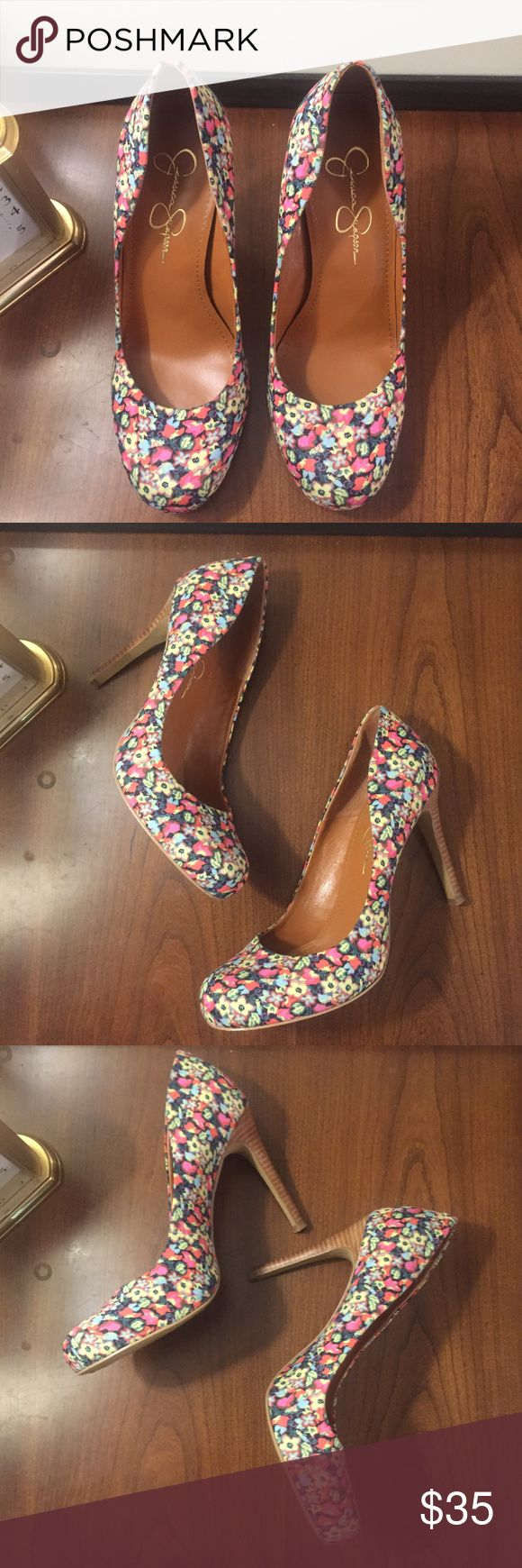 Jessica Simpson Given Floral Pump (8) Excellent condition.  No rips, stains, or tears.  Strike a stylish pose in this supple Jessica Simpson pump. The Given brings you a flower fabric upper with a 1 inch platform and 4 1/2 inch heel height. You can't go wrong with this genius style, you'll look amazing all day! Shoe Details:      Fabric Upper     Man Made Sole     Made In China     This Shoe fits true to size. Jessica Simpson Shoes Heels