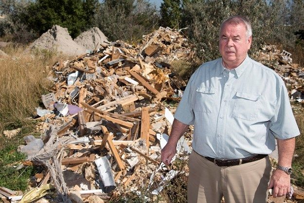 Mississauga man is facing thousands of dollars in waste disposal fees after truckloads of construction material were illegally dumped on his property.  Mike Orlok, owner of Mikor Metal Products Inc., discovered dump trucks full of wood, sludge, metal debris, concrete cinder blocks, shingles, drywall and other building materials scattered in the field behind his business. With no idea who is responsible for dropping the load, Orlok is now on the hook for paying the disposal fees, which could…