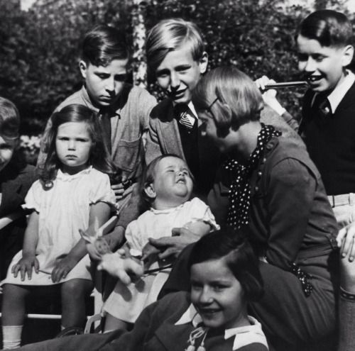 Helga Goebbels and Hilde Goebbels playing in their garden with brother Harald Quandt and his friends. 1935.